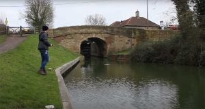 lure-fishing-for-pike-by-a-canal-bridge